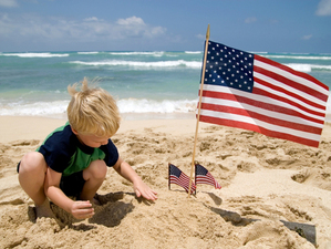 Boy with American Flags on a Beach